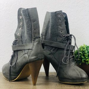Grey heeled leather ankle boots with buckle